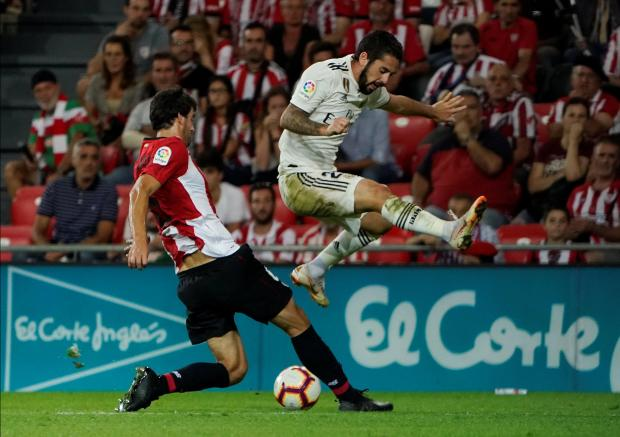 Real's Isco (right) is tackled by Mikel San Jose, of Bilbao.