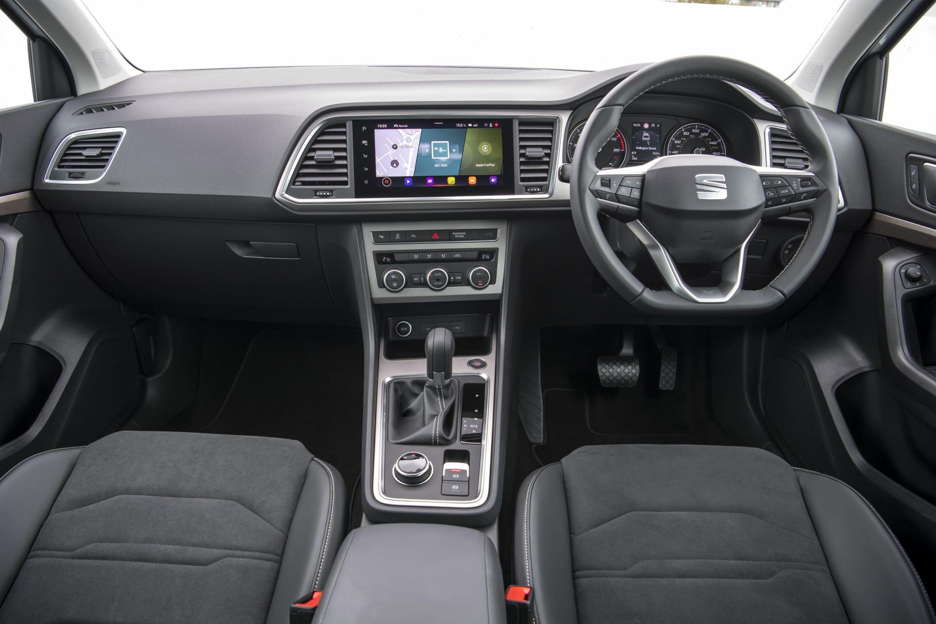 A large infotainment screen sits in the middle of the dash.