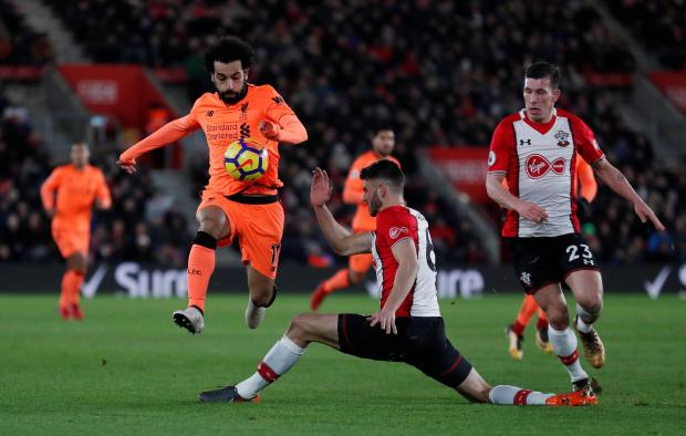 Liverpool's Mohamed Salah in action with Southampton's Wesley Hoedt.
