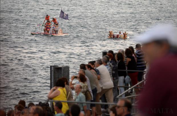 Raft builders take part in a race across the Grand Harbour during the Valletta Pageant of the Seas on June 7. Photo: Matthew Mirabelli