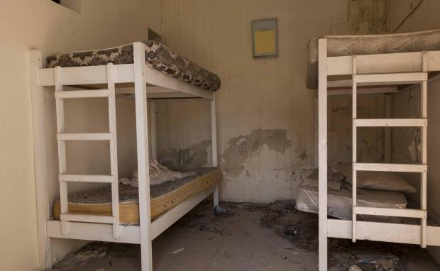 Mattresses sag in one of the complex's abandoned bungalows. Photo: Alessandro Tesei