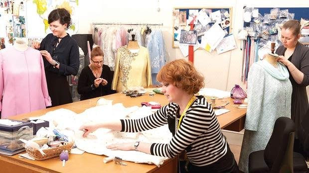 The royal dressmakers at work.