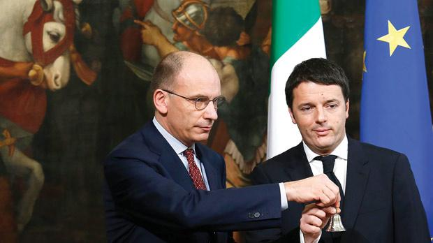 Newly appointed Italian Prime Minister Matteo Renzi (right) ringing a silver bell to signify the start of his first Cabinet meeting, next to his predecessor Enrico Letta, at Chigi Palace in Rome, on Saturday. Photo: Remo Casilli /Reuters