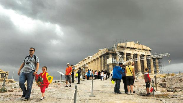 Clouds gather over the Parthenon atop the ancient hill of the Acropolis. Greeks were kept in complete darkness about the lack of sustainability of their lavish lifestyles financed by generous pay packets and social benefits. Photo: Reuters