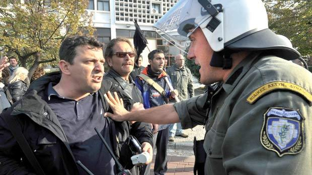 A protester argues with a policeman during an anti-austerity rally in Thessaloniki, northern Greece, last week. The much dreaded devaluation is perhaps the only credible solution left to restore competitiveness in a country that is bankrupt. Photo: Reuters