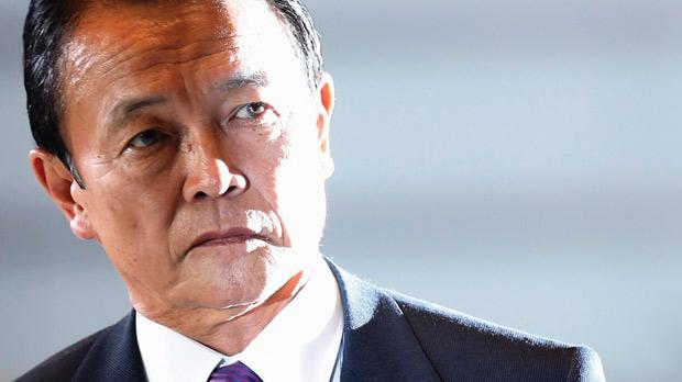 Japan's newly-appointed Finance Minister Taro Aso, a veteran lawmaker and former premier, arrives at the Prime Minister's official residence in Tokyo yesterday. Prime Minister Shinzo Abe has given him a mandate to help push his policies of drastic monetary easing and big spending to beat deflation and tame the strong yen.