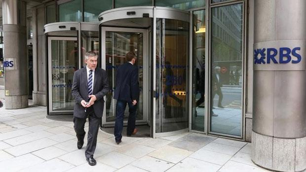 A man leaving an RBS building in London. Photo: Paul Hackett/Reuters
