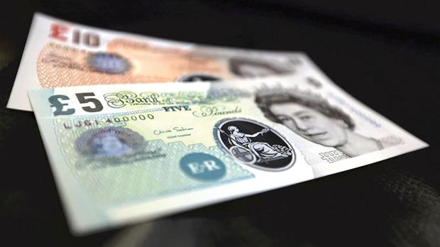 Sample polymer £5 and £10 banknotes on display at the Bank of England in London. Photo: Chris Ratcliffe/Reuters
