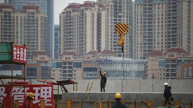 Labourers working at a construction site for a new building in Shanghai. Photo: Aly Song/Reuters