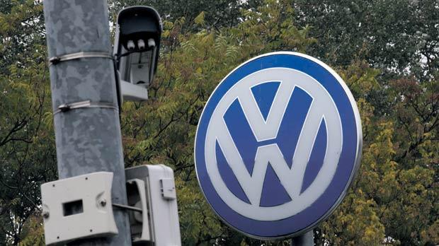 A Volkswagen logo stands next to a CCTV security camera in Wolfsburg, Germany, yesterday. Photo: Axel Schmidt/Reuters