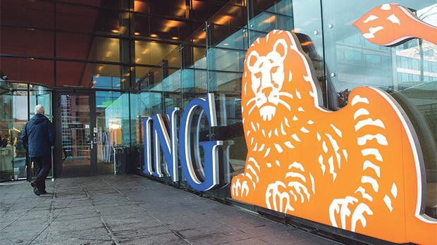 A man walking past the logo of ING Group NV at a branch office in Amsterdam. Photo: Reuters