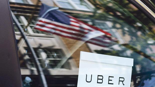 An Uber sign is seen in a car in New York, US. Photo: Reuters