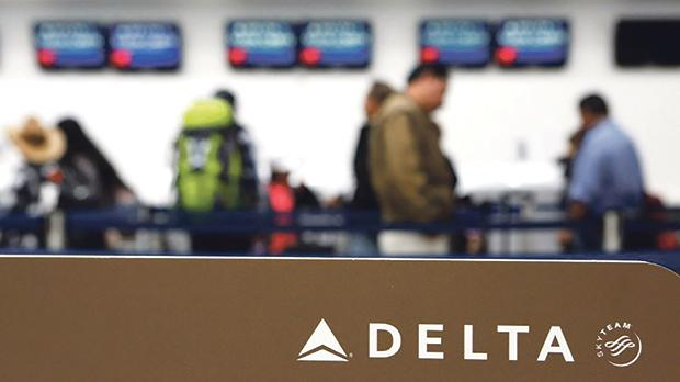 Passengers checking in at a counter of Delta Air Lines. Photo: Ginnette Riquelme/Reuters