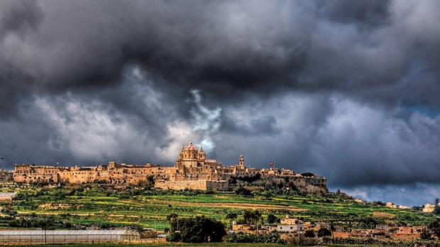 A storm brews over Mdina. Climate change models forecast less rain but more storms for Malta, resulting in less freshwater available to recharge depleting groundwater sources. Photo: Neil Howard