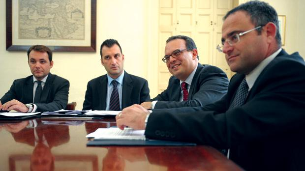 Ernst and Young country manager Ronald Attard (third from left) flanked by senior manager Simon Lee Barberi (left) and Malta Chamber's director-general Kevin Borg, with Finance Malta head of business development Bruno L'ecuyer (first left). Almost 100 foreign-owned businesses have been interviewed to gather views on Malta's business friendliness. Photo: Matthew Mirabelli