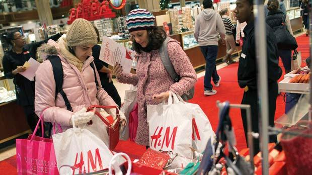Shoppers browsing at Macy's in New York, yesterday. Black Friday, the day following Thanksgiving, has traditionally been the busiest shopping day in the US. Photo: Reuters