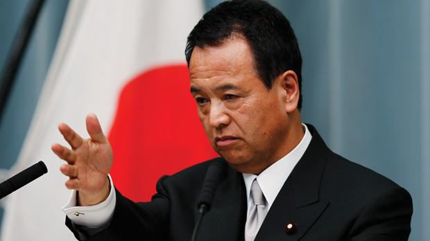 Japan's newly-appointed Minister for Economic Revival, Akira Amari, speaking at a news conference in Tokyo .