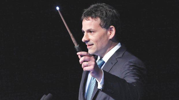 David Einhorn, president of Greenlight Capital, holding a toy wand while speaking at a conference in New York. Greenlight Capital has filed suit against Apple Inc in federal court in New York, saying the company needs to do more to unlock value for shareholders. Photo: Reuters