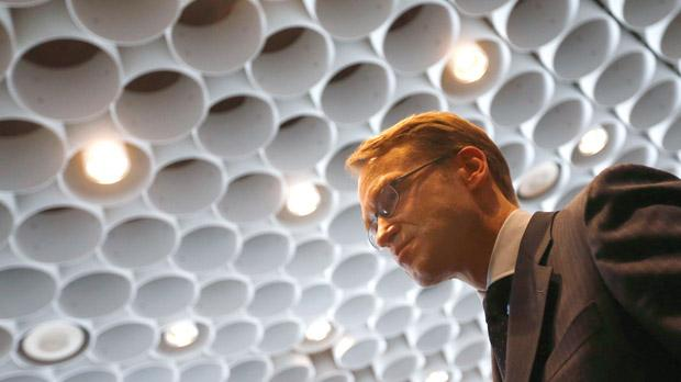 Jens Weidmann, president of Germany's Bundesbank, leaving the conference room after the bank's annual news conference in Frankfurt, yesterday. The Bundesbank's 2012 profit remained broadly unchanged at €664 million, less than half of what the German government was expecting, as the Central Bank put more money aside to protect it from the euro zone debt crisis. Photo: Reuters