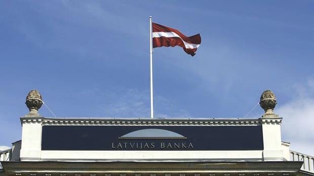 Latvia's flag waving over the Central Bank's main office building in Riga. The Central Bank said last week it had not seen any big flows of Russian money. Photo: Reuters
