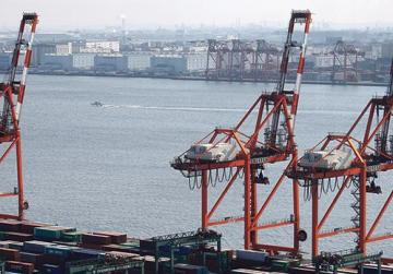 Shipping containers in a port in Tokyo. Photo: Issei Kato/Reuters