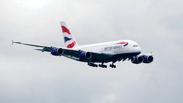 British Airways' new Airbus A380 about to land at Heathrow airport in London yesterday. Photo: Paul Hackett/Reuters