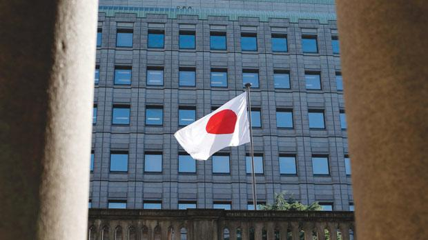 A Japanese flag fluttering at the Old Building of Bank of Japan's head office in Tokyo. Photo: Toru Hanai/Reuters