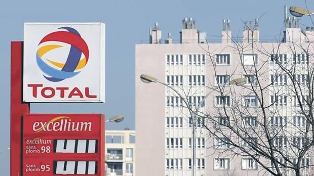 A logo at a Total gas station in Marseille. Photo: Jean-Paul Pelissier/Reuters