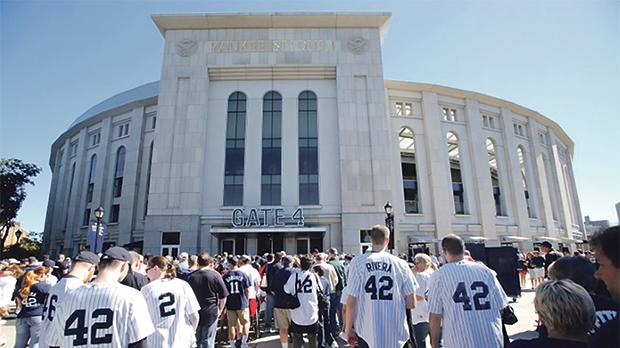 Fans wearing the number 42 of New York Yankees relief pitcher Mariano Rivera lining up to enter the stadium before their MLB Interleague game with the San Francisco Giants at Yankee Stadium in New York, US. Photo: Reuters