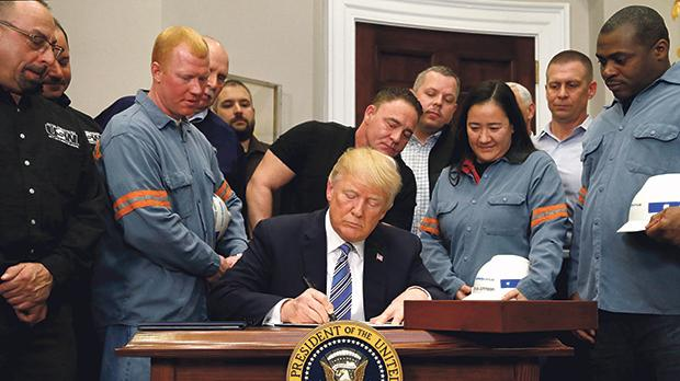 US President Donald Trump signs a presidential proclamation placing tariffs on steel and aluminum last week. Photo: Reuters