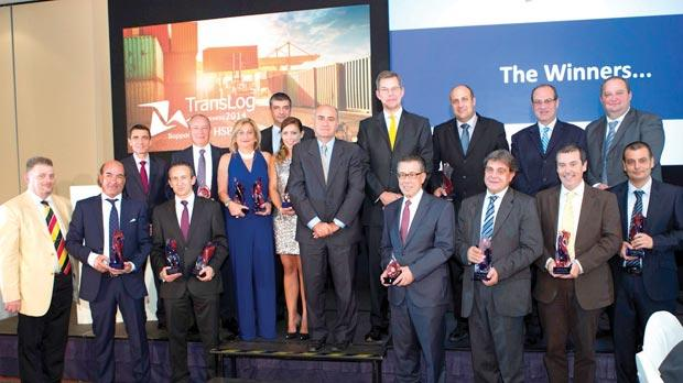 Parliamentary Secretary José Herrera (centre), HSBC Bank Malta CEO Mark Watkinson and HSBC Bank Malta head of commercial banking Michel Cordina with winners of the TransLog Awards 2014. Also seen are Alex Borg, director SSM Group (left) and David Brockdorff, managing director BPC International (second row, left).