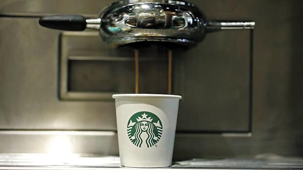 A paper cup at Starbucks' Vigo Street branch in Mayfair, central London. Photo: Stefan Wermuth/Reuters