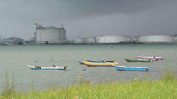 Boats floating in front of the Vopak oil storage terminal in Johor, Malaysia. Photo: Reuters