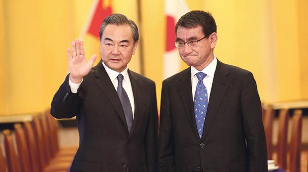 Chinese State Councillor and Foreign Minister Wang Yi (left) and Japan's Foreign Minister Taro Kono at a meeting in Tokyo, Japan on Sunday. Photo: Reuters