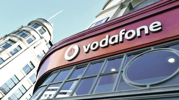 Branding for Vodafone on the exterior of a shop in London, Britain. Photo: Toby Melville/Reuters