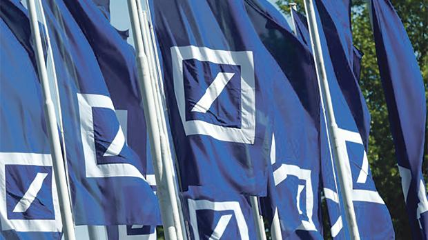 Flags with the logo of Deutsche Bank at the company's headquarters in Frankfurt, Germany. Photo: Reuters