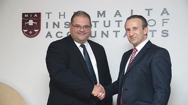 Malta Institute of Accountants president William Spiteri Bailey, left, with his predecessor, Franco Azzopardi.