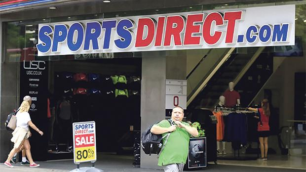 Sports Direct chain sees profits halved