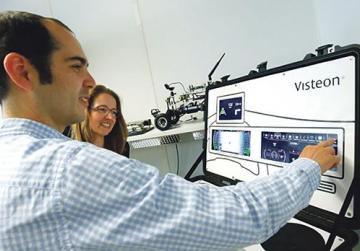 Alexandra Schaefer, head of the SmartCore-Centre of Competence, and her colleague Hector Zarate of US automotive supplier Visteon working on a set-up to demonstrate their new SmartCore dashboard in Karlsruhe, Germany. Photo: Reuters