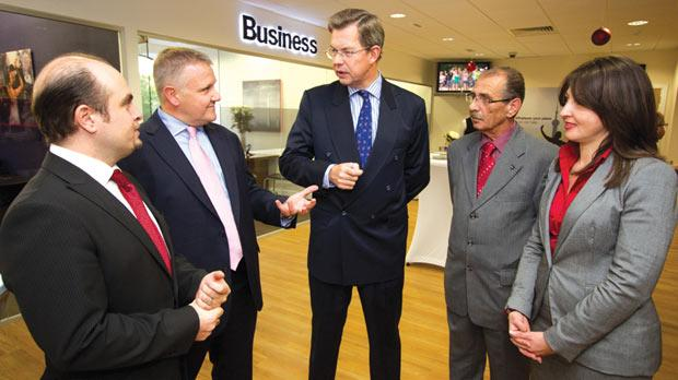 HSBC Malta chief executive Mark Watkinson (centre) with (from left) Sergio Bellizzi, Paul Steel, Żabbar mayor Domenic Agius and Julie Bonnici at the reopening of the Żabbar branch.