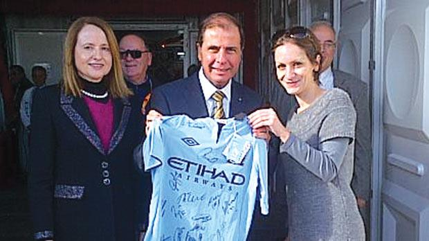 President George Abela and his wife Margaret with Shakyra Dalli, who presented the Manchester City top, on behalf of BML Group.
