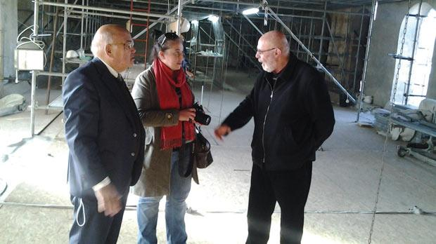 Ray Bondin, left, inspecting the restoration works being carried out on the Church of the Nativity in Bethlehem, accompanied by local officials.
