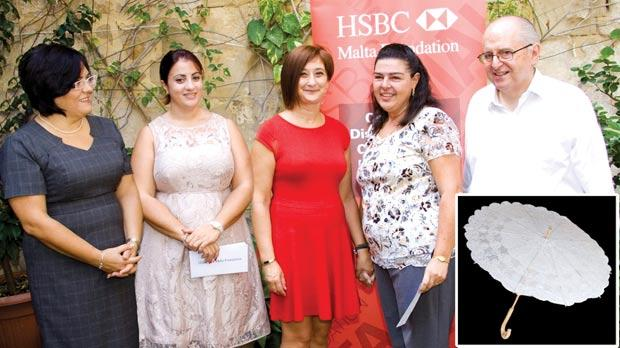 Winner of this year's Malta Lace Competition Carmen Ellul (second from right) with (from left) HSBC's Doriette Camilleri, Cristina Farrugia, HSBC's deputy CFO Josephine Magri and Marquis Nicholas de Piro.