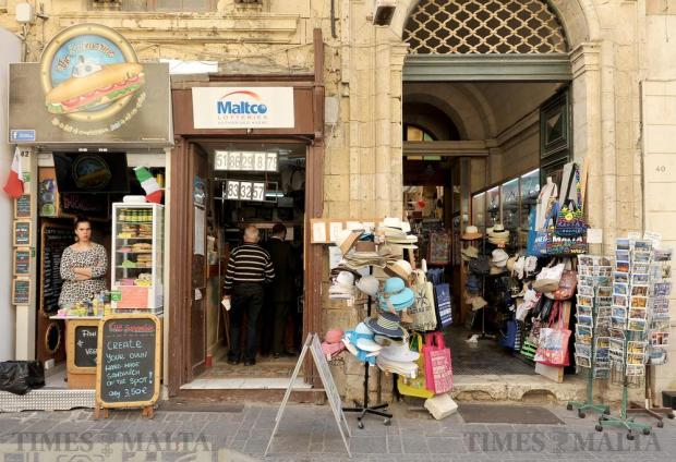 Shops and shoppers in Merchant Street in Valletta on April 20. Photo: Chris Sant Fournier