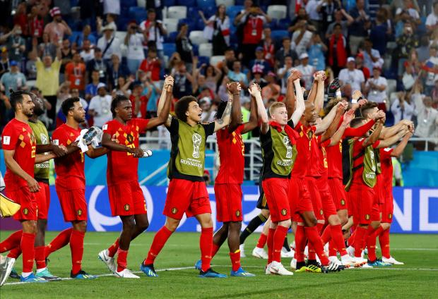 Belgium players celebrate after the match.