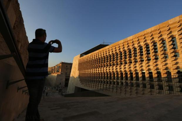 A man takes a picture of the new parliament building in Valletta on October 8. The building is still not ready for MPs to use after works fell behind schedule for the umpteenth time. Photo: Darrin Zammit Lupi