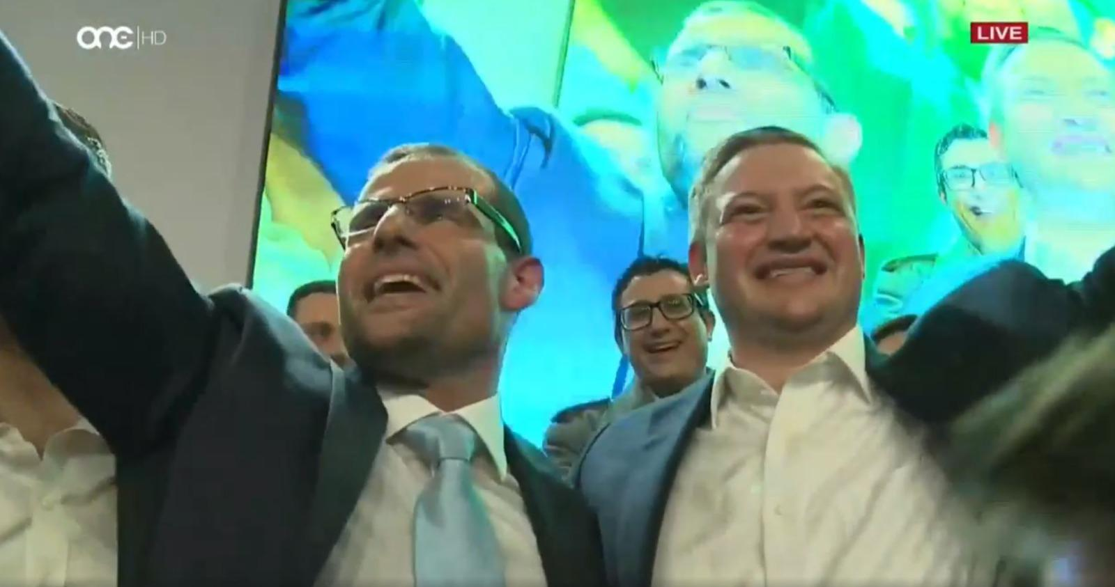 Robert Abela and Konrad Mizzi smile and wave ahead of Abela's first speech as Labour leader in January 2020.