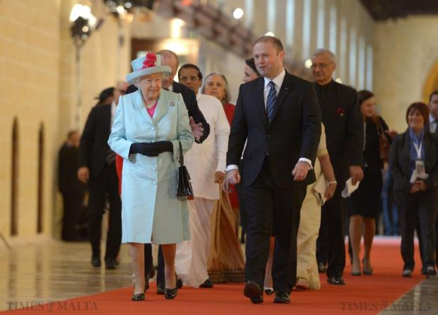 Queen Elizabeth II, accompanied by Prime Minister of Malta Joseph Muscat, arrives for the opening ceremony of the Commonwealth Heads of State Summit in Valletta on November 27. Photo: Matthew Mirabelli