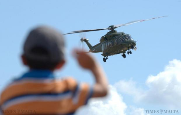 A young boy waves at a helicopter taking part in the Malta International Airshow on September 27. Photo: Matthew Mirabelli