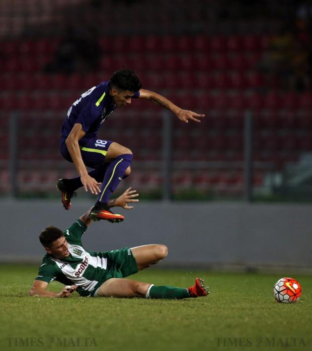 St Andrew's Ivan Edgardo Paz leaps over Floriana's Enzo Ruiz during their Premier League football match at the Hibernians Stadium in Corradino on August 27. Photo: Darrin Zammit Lupi